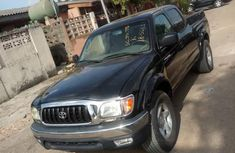 Black 2004 Toyota Tacoma suv / crossover automatic at mileage 220,000 for sale