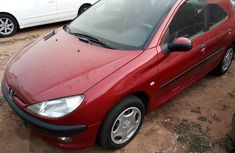 Best priced red 2000 Peugeot 206 at mileage 180