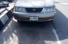 Sell cheap gold 1999 Toyota Avalon automatic at mileage 215