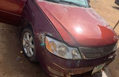 Sell cheap red 2000 Toyota Avalon sedan automatic in Lagos