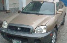 Sell cheap gold 2005 Hyundai Santa Fe automatic