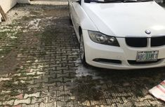 White 2008 BMW 320i car at mileage 170,000 at attractive price