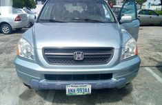 Sell well kept green 2004 Honda Pilot automatic at price ₦2,200,000