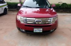 Neatly used red 2008 Ford Edge automatic in Owerri