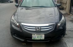 Best priced grey/silver 2011 Honda Accord at mileage 70,000