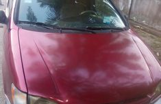 Red 1999 Toyota Sienna van automatic at mileage 190,435 for sale