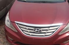 Selling red 2013 Hyundai Sonata automatic in Ikeja