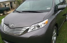 Grey/silver 2014 Toyota Sienna automatic at mileage 40,896 for sale in Lagos