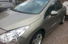 Sell gold 2011 Peugeot 408 automatic at price ₦1,500,000