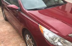 Sell cheap red 2011 Hyundai Sonata sedan automatic at mileage 50,000