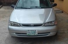 Sell used grey/silver 2001 Toyota Corolla at mileage 94,000