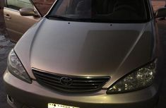 Sell gold 2005 Toyota Camry automatic at price ₦900,000 in Lagos
