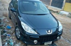 Need to sell cheap used grey/silver 2005 Peugeot 307 manual in Abuja