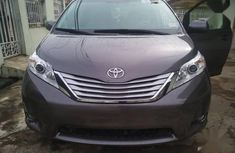 Used grey/silver 2014 Toyota Sienna automatic for sale in Lagos