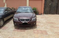 Selling brown 2005 Hyundai Sonata automatic at mileage 15,000