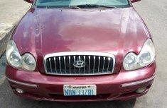 Selling red 2004 Hyundai Sonata sedan in good condition
