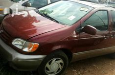 Very sharp neat red 2001 Toyota Sienna for sale in Lagos