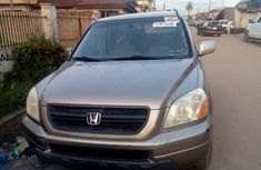 Gold 2005 Honda Pilot automatic at mileage 97,924 for sale
