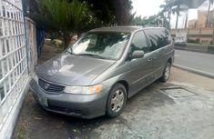 Need to sell cheap used grey/silver 2001 Honda Odyssey van in Ikeja