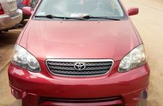 Certified red 2002 Toyota Corolla automatic in good condition