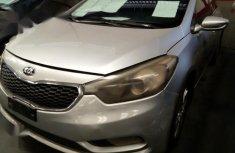 Best priced grey/silver 2014 Kia Cerato automatic in Ikeja