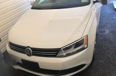 Need to sell high quality white 2013 Volkswagen Jetta sedan automatic in Lagos