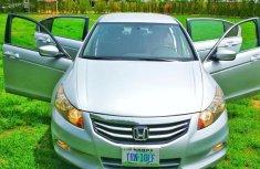 Grey/silver 2011 Honda Accord car at attractive price in Kaduna