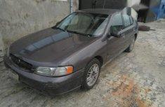 Sell cheap brown 2002 Nissan Altima sedan automatic