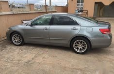 Selling grey/silver 2009 Toyota Camry sedan in good condition