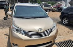 Used gold 2011 Toyota Sienna car automatic at attractive price