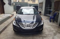 Clean 2013 Hyundai Sonata sedan automatic for sale in Ikeja