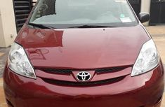 Clean red 2010 Toyota Sienna automatic car at attractive price