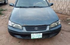 Used green 1999 Toyota Camry sedan at mileage 35,000 for sale