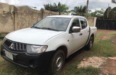 White 2007 Mitsubishi L200 car at attractive price in Enugu