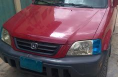 Selling authentic 1999 Red Honda CR-V in Lagos