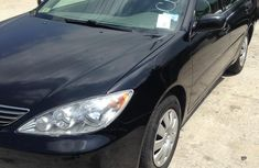 Need to sell high quality black 2006 Toyota Camry automatic at price ₦1,650,000
