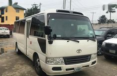 Sell well kept white 2015 Toyota Coaster automatic