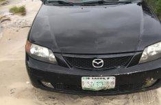 Authentic black 2002 Mazda Protege automatic in good condition