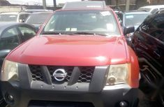 Red 2005 Nissan Xterra automatic at mileage 89,524 for sale in Lagos