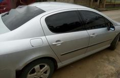 Grey/silver 2007 Peugeot 407 at mileage 88,850 for sale in Uyo