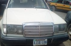 Need to sell white 1999 Mercedes-Benz 220E sedan at price ₦250,000