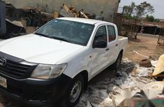 Clean white 2013 Toyota Hilux manual for sale at price ₦4,750,000