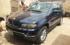 Blue 2006 BMW X5 car automatic at attractive price in Lagos