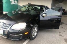 Sell well kept black 2009 Volkswagen Jetta sedan automatic in Lagos