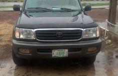 Need to sell used black 2001 Toyota Land Cruiser automatic at cheap price