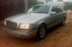 Sell well kept grey/silver 2002 Mercedes-Benz C180 sedan at price ₦550,000