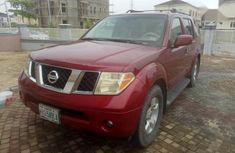 Need to sell high quality red 2006 Nissan Pathfinder automatic