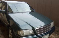 Selling green 2000 Mercedes-Benz C220 automatic