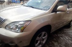Clean gold 2005 Lexus RX automatic car at attractive price