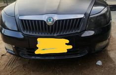 Sell cheap black 2010 Skoda Octavia automatic at mileage 10,000